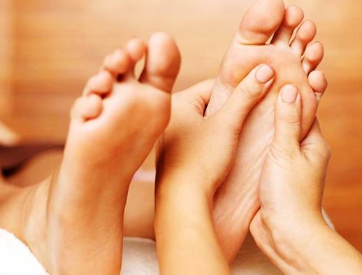 Posicionamiento de masaje de pies